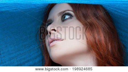 Portrait Of Stylish Caucasian Woman With Blue Scarf