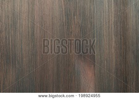 Natural color wooden board surface. Textured background from mocha wood planks. Vertical grain.