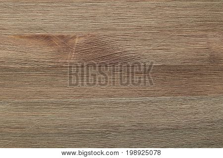 Natural color wooden board surface. Textured background from woodnut planks. Horizontal grain.