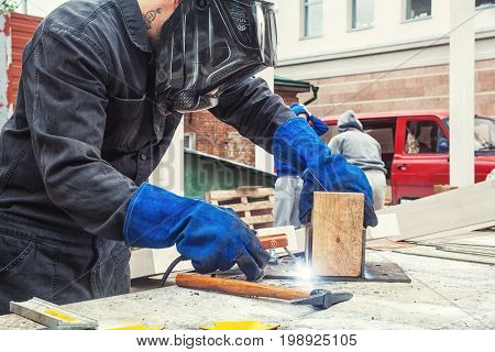 Welder Is Welding A Mettalic Construction