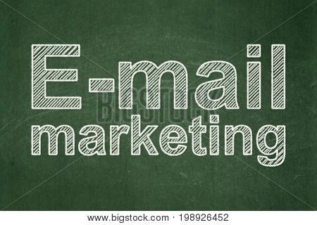 Marketing concept: text E-mail Marketing on Green chalkboard background