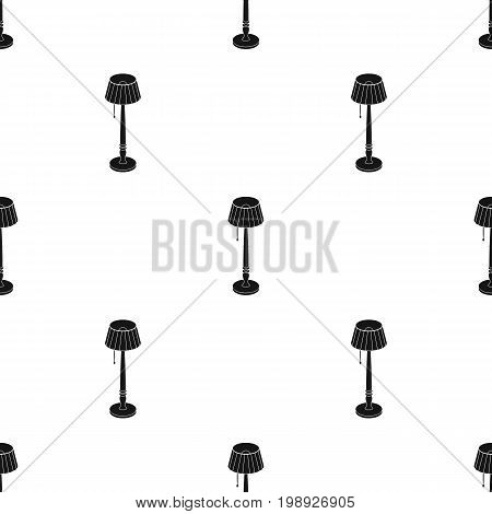Wooden floor lamp icon in black design isolated on white background. Library and bookstore symbol stock vector illustration.