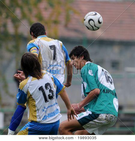 KAPOSVAR, HUNGARY - OCTOBER 16: Bence Kovacs (R) in action at the Hungarian National Championship under 17 game between Kaposvar and Kozarmisleny October 16, 2010 in Kaposvar, Hungary.