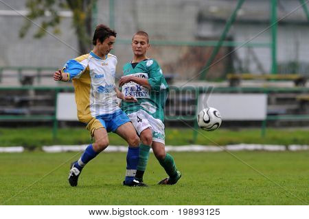 KAPOSVAR, HUNGARY - OCTOBER 16: Attila Zsebe (R) in action at the Hungarian National Championship under 17 game between Kaposvar and Kozarmisleny October 16, 2010 in Kaposvar, Hungary.