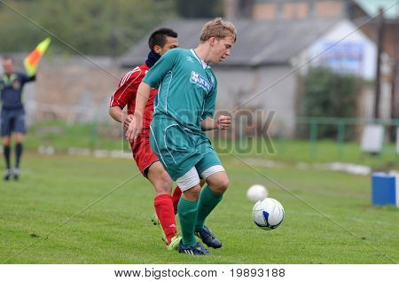 KAPOSVAR, HUNGARY - OCTOBER 16: Krisztian Mikola (R) in action at the Hungarian National Championship under 19 game between Kaposvar and Debrecen October 16, 2010 in Kaposvar, Hungary.