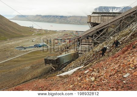 LONGYEARBYEN, NORWAY - SEPTEMBER 01, 2011: View to the town of Longyearbyen with the abandoned coal mine at the foreground, Norway.