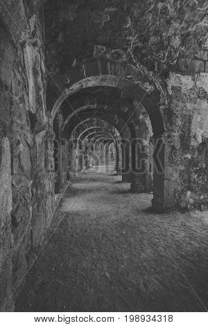 Internal passages in the ancient Roman amphitheater of Aspendos. The province of Antalya. Mediterranean coast of Turkey. Black and white. Stylization.