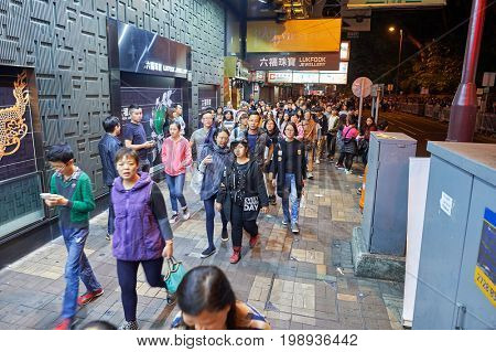 HONG KONG - 25 DECEMBER 2015: crowds of people at night on streets of Kowloon. Kowloon is an area in Hong Kong comprising the Kowloon Peninsula and New Kowloon.