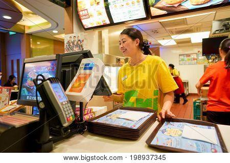 HONG KONG - CIRCA NOVEMBER, 2016: inside of a McDonald's restaurant in Hong Kong. McDonald's, or simply McD, is an American hamburger and fast food restaurant chain.