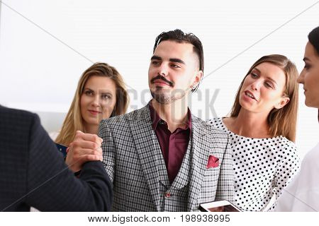 Smiling man and woman shake hands as hello in office portrait. Friend welcome mediation offer positive introduction greet or thanks gesture summit participate approval strike arm bargain concept