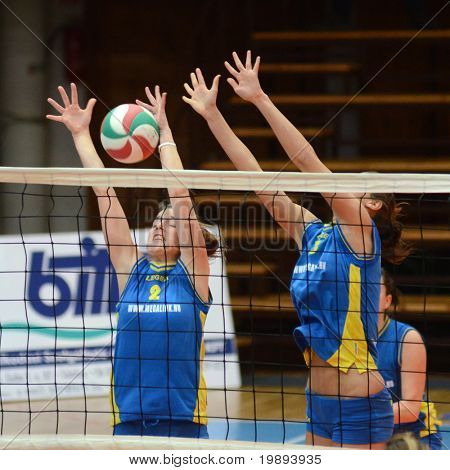 KAPOSVAR, HUNGARY - JANUARY 14: Zsanett Pinter (L) blocks the ball at the Hungarian NB I. League woman volleyball game Kaposvar vs Ujbuda, January 14, 2011 in Kaposvar, Hungary.