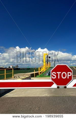 Stop sign on the road of loading on the ferry in the terminal of the passenger port of the Baltic Sea