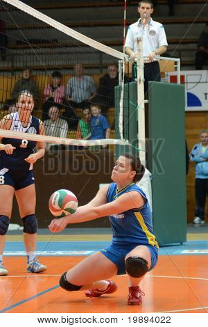 KAPOSVAR, HUNGARY - JANUARY 14: Marianna Palfy (R) in action at the Hungarian NB I. League woman volleyball game Kaposvar vs Ujbuda, January 14, 2011 in Kaposvar, Hungary.