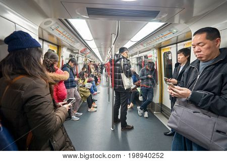 HONG KONG - CIRCA JANUARY, 2016: passengers at a MTR train. The Mass Transit Railway is the rapid transit railway system in Hong Kong.