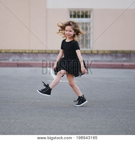 cute little girl dancing on the street