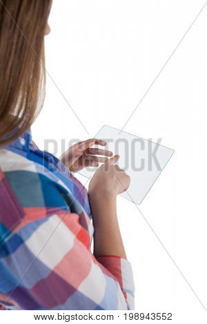 Rear view of girl using a glass digital tablet against white background