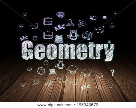 Learning concept: Glowing text Geometry,  Hand Drawn Education Icons in grunge dark room with Wooden Floor, black background