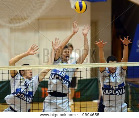 KAPOSVAR, HUNGARY - JANUARY 28: Krisztian Csoma (C) blocks the ball at a Middle European League volleyball game Kaposvar (HUN) vs. Mladost Zagreb (CRO), January 28, 2011 in Kaposvar, Hungary.