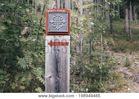 Sign for attraction on a path in norwegian forest