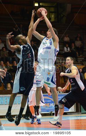 KAPOSVAR, HUNGARY - JANUARY 26: Soma Kovacs (8) in action at a Hugarian Cup basketball game Kaposvar vs. Szeged January 26, 2011 in Kaposvar, Hungary.