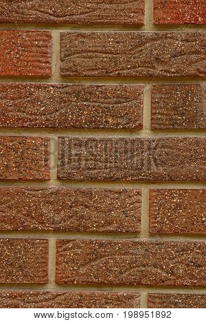 Brown bricks texture of a house wall fragment