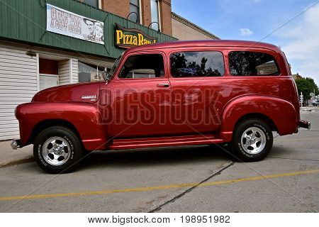 CASSELTON, NORTH DAKOTA, July 27, 2017: The annual Casselton Car Show which occurs the last Thursday of July features classic vehicles such as the restored and customized 1949 Chevy passenger van.