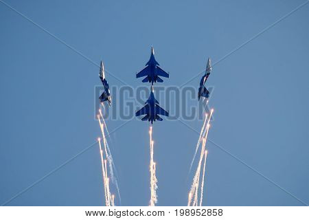 Moscow Region - July 21, 2017: Aerobatic display team Russian Knights on Su-30SM in the blue sky at the International Aviation and Space Salon (MAKS) in Zhukovsky.