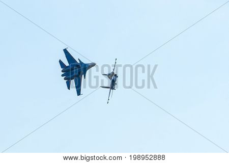Moscow Region - July 21, 2017: Aerobatic display team Russian Knights on Su-30SM performs a trick at the International Aviation and Space Salon (MAKS) in Zhukovsky.