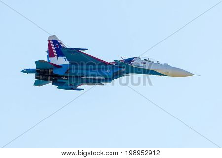 Moscow Region - July 21, 2017: Russian strike fighter Sukhoi Su-30 from Russian Knights team flies at the International Aviation and Space Salon (MAKS) in Zhukovsky.