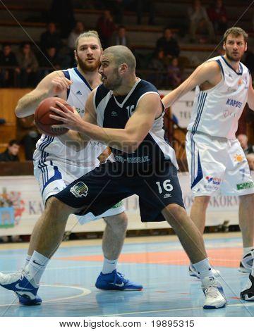 KAPOSVAR, HUNGARY - JANUARY 26: Kurt Cunningham (L) in action at a Hugarian Cup basketball game Kaposvar vs. Szeged January 26, 2011 in Kaposvar, Hungary.