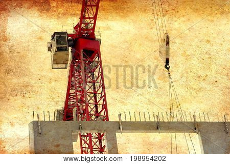 Illustration of modern urban building under construction with a crane and blue sky with ancient grunge effect and copy space