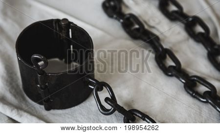 Prison Shackles on a White Shirt Russia