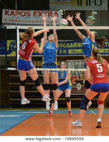 KAPOSVAR, HUNGARY - FEBRUARY 4: Zsanett Pinter (2) blocks the ball at the Hungarian NB I. League woman volleyball game Kaposvar vs Szolnok, February 4, 2011 in Kaposvar, Hungary.