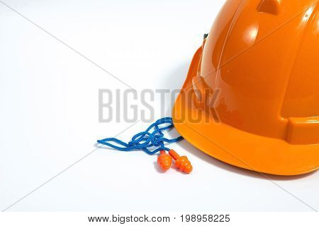 Orange Reusable Ear Plugs In Construction Site, Personal Safety Equipment Concept.