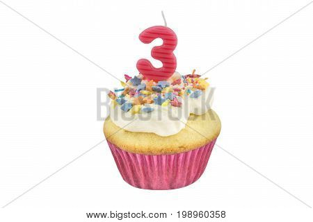 Happy birthday cup cake with star sprinkles and number 3 pink candle on white table with pink background - Birthday celebration background for a little girl - photo