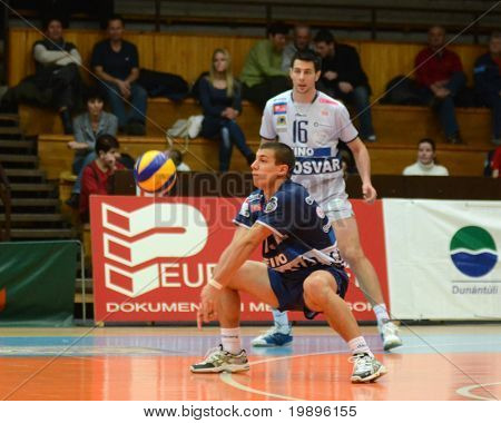KAPOSVAR, HUNGARY - FEBRUARY 20: Mark Deak (in blue) in action at a Middle European League volleyball game Kaposvar (HUN) vs Kastela (CRO), February 20, 2011 in Kaposvar, Hungary.