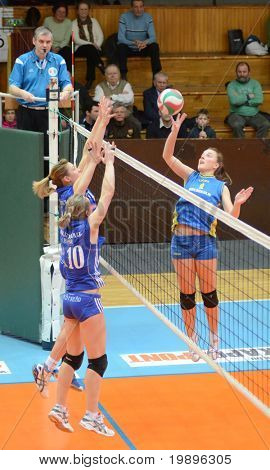 KAPOSVAR, HUNGARY - FEBRUARY 13: Zsanett Pinter (R) in action at the Hungarian NB I. League woman's volleyball game Kaposvar vs Bekescsaba on February 13, 2011 in Kaposvar, Hungary.