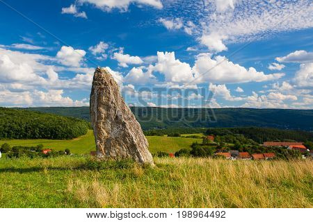 Millennium menhir on the hill at sunset