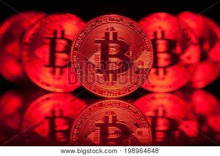 Five Red Virtual Coins Bitcoins On Printed Circuit Board.