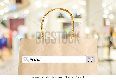 Word www. on search bar over shopping bag and blur store background online shopping background business E-commerce web banner poster
