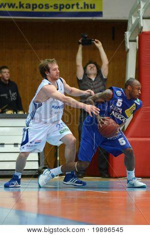 KAPOSVAR, HUNGARY - FEBRUARY 26: Joshua Wilson (L) in action at a Hungarian National Championship basketball game Kaposvar vs Albacomp on February 26, 2011 in Kaposvar.