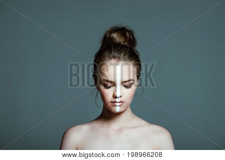 Young Beautiful Teen Girl With Closed Eyes And Creative White Body Art Line On Face, Isolated On Gre