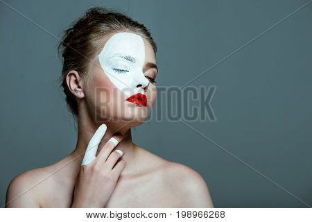 Young Beautiful Tender Teen Girl With Closed Eyes And Creative White Bodyart On Face, Isolated On Gr