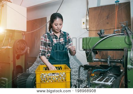 Young Milling Machining Female Employee Seriously