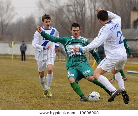 KAPOSVAR, HUNGARY - MARCH 5: Krisztian Kirchner (in green) in action at the Hungarian National Championship under 19 game between Kaposvar and MTK on March 5, 2011 in Kaposvar, Hungary.