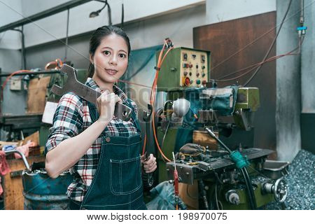 Smiling Lathe Factory Worker Looking At Camera