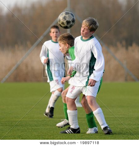 KAPOSVAR, HUNGARY - MARCH 9: Bence Keszthelyi (R) in action at the Hungarian National Championship under 13 game between Kaposvar and Airnergy FC on March 9, 2011 in Kaposvar, Hungary.