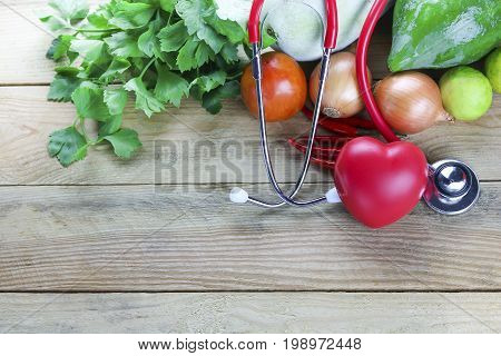 Healthy hearth concept vegetable and fruit with herb leaf and ear doctor on wood background