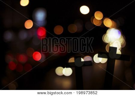 silhouette of cross wood with bokeh background concept as halloween belive and spiritual in Christian