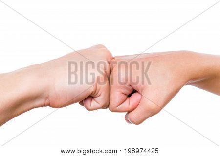 Close-up hands of boy and girl are banging their fists. Fist bump isolated on white background.